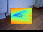 An infrared shot of a cold spot in a kitchen floor, under the dishwasher.