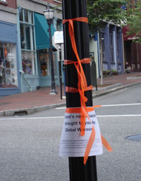 """Orange tape marks the new Portland """"coastline"""" if global warming pollution isn't curbed. (photo by Judy Berk)"""