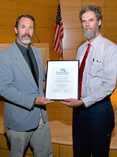 Zip Kellogg (right) accepts a 2011 Environmental Award for Lifetime Achievement awarded posthumously to his sister, Judy Kellogg Markowsky, a long-time naturalist and environmental educator.