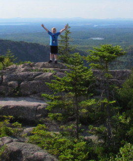 Boy on Pemetic Mountain at Acadia National Park