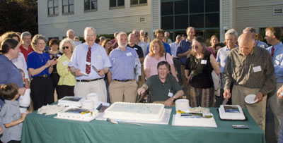 Bill Townsend, Lee Patterson, and Ron Davis cut the cakes.