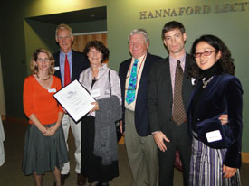Eleanor Kinney and Brownie Carson congratulate artist Evelyn Dunphy (third from left) and her family as she receives NRCM's 2009 People's Choice Award. Watch video.