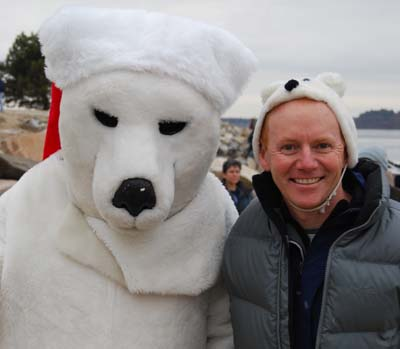 Pete Didisheim greets one of the polar bears who came to watch the plunge.