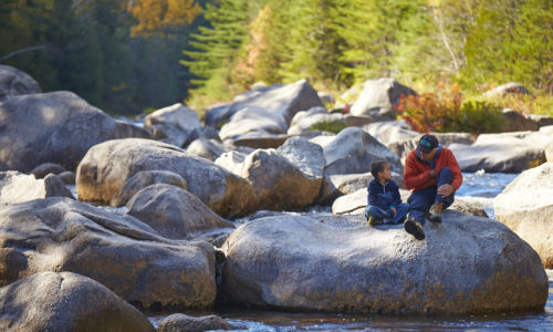 man and boy at KWW national monument. Photo courtesy of Katahdin Woods and Waters.