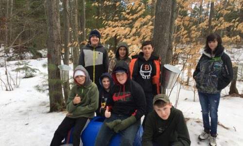 Brewer Community School science students learn how to tap sugarbush trees.