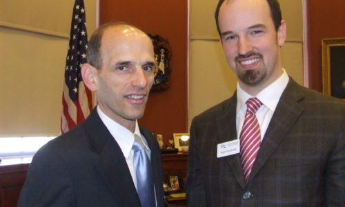 NRCM's Matt Prindiville and Governor John Baldacci at Product Stewardship Bill signing