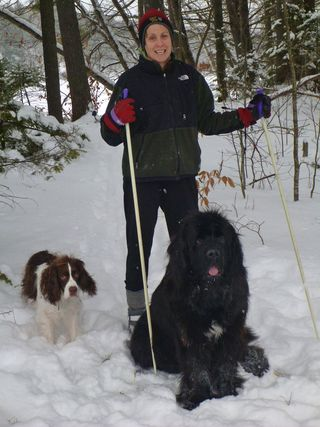 Patty skiing with her dogs at her camp in Norridgewock.