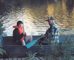 Beth fishing with her Grampa Dimond in Echo Lake in Fayette in 1986.