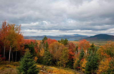 From the Rangeley Overlook on Route 17 south of Oquossoc. It looks north toward Haines Landing at the confluence of Mooselookmeguntic and Cupsuptic Lakes. Photo by Tony Nazar
