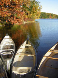 Canoes on Lower Narrows Pond, Winthrop. Photo by Beth Dimond.