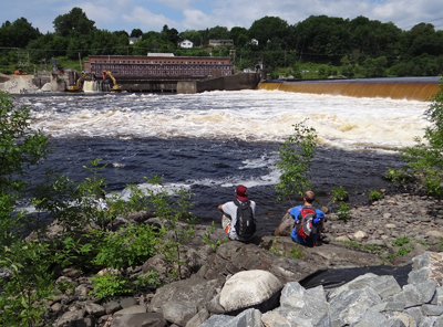 People gathered to watch the start of the removal of the Veazie Dam as part of the Penobscot River Restoration Project. 2013 photo.