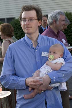 Dylan Voorhees, NRCM's clean energy project director, and his youngest daughter enjoy the party.