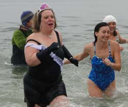 Beth Dimond (in the tiara) and others race out of the ocean as fast as they can. 38 degrees is NOT the ideal water temperature for a leisurely swim.