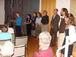 Cathy Johnson, NRCM's North Woods Project Director and Staff Attorney, addresses the audience after the film premiere. Also pictured are (second from left) Judy Berk, NRCM's communications director and executive producer of the film, and people who were interviewed and featured in the movie.