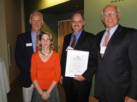 Russell Pierce (second from right) of the law firm Norman, Hanson and DeTroy (pictured with Brownie Carson, Eleanor Kinney and Peter DeTroy) received an Environmental Award for his countless hours of work to protect the Moosehead Lake region from Plum Creek's massive development plan. Watch video.