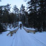 skier crossing footbridge