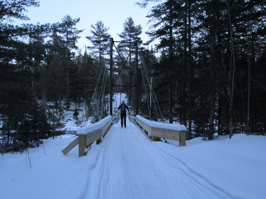 skier crossing footbridge
