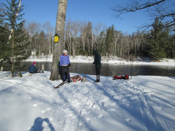 skiers taking break along Penobscot