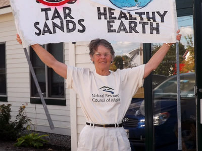 Cathy Johnson with climate sign