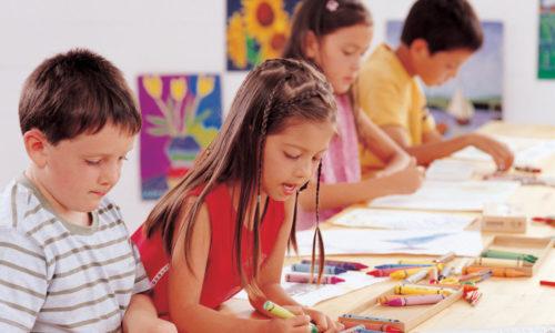 Kids in school coloring