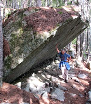 Lisa holding up boulder