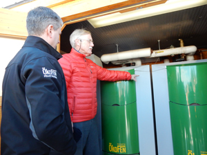 Senator King takes a closer look at the wood pellet boiler put in by Maine Energy Systems.