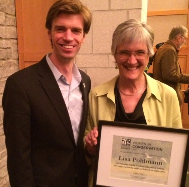 NRCM CEO Lisa Pohlmann is congratulated by Collin O'Mara, President and CEO of the National Wildlife Federation, on her 2015 Women in Conservation Award.