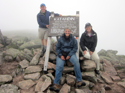 Pete Didisheim, Lisa Pohlmann, and Cathy Johnson at the top of Mount Katahdin