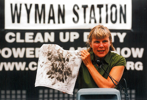 Carol Bass with handkerchief at Wyman press conference 2001