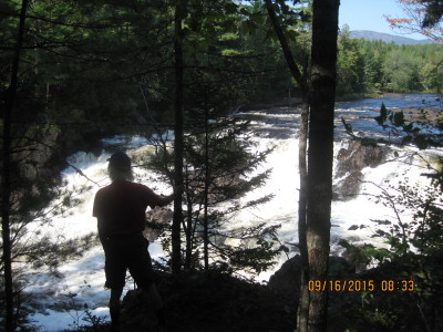 Hartley viewing some rapids on the East Branch
