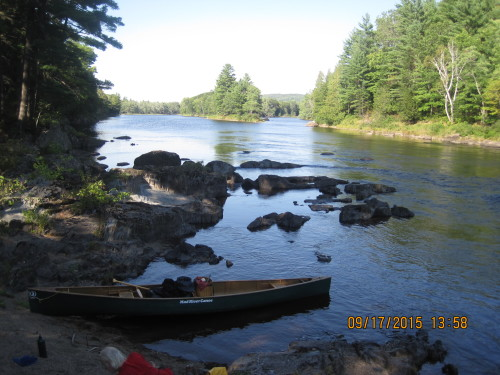 River view of East Branch with canoe