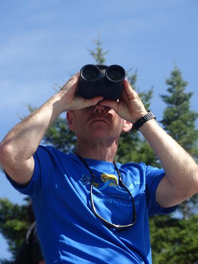 Pete using binoculars on Barnard Mountain hike