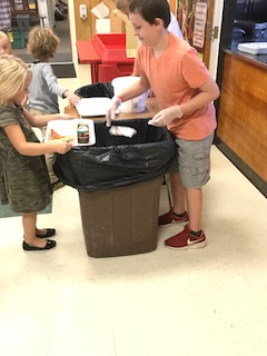 students sorting lunch trash at Sebago Elementary