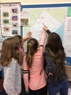 Students studying map at Loranger Memorial School