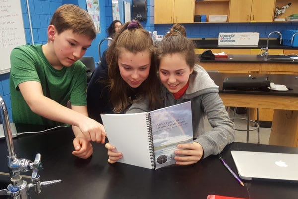 Hope Elementary School 7th Graders Aaron, Guine, and Sophie learning about invasive plants in Maine.