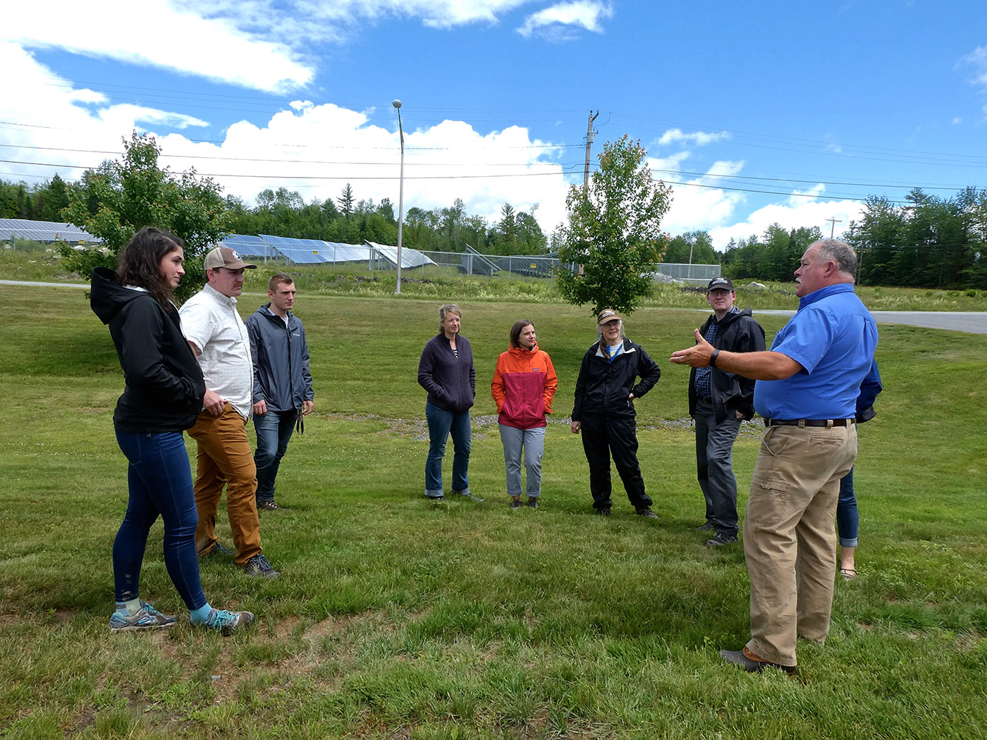 Superintendent Calvin Ames of Madison Electric Works speaks with NRCM staff during a recent visit.