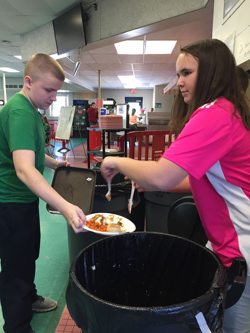 students helping compost food waste
