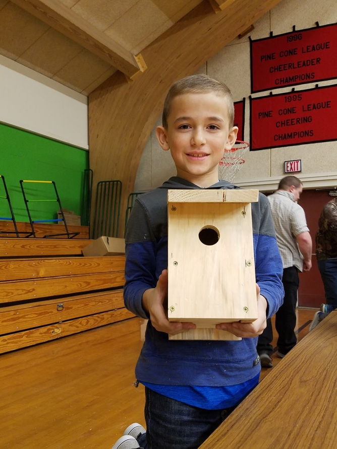 Finn shows off his completed chickadee house