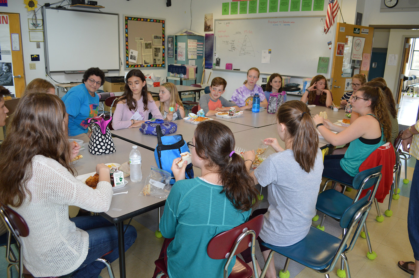 Environmental Club students at Hall-Dale Middle School discuss how their composting program is going.
