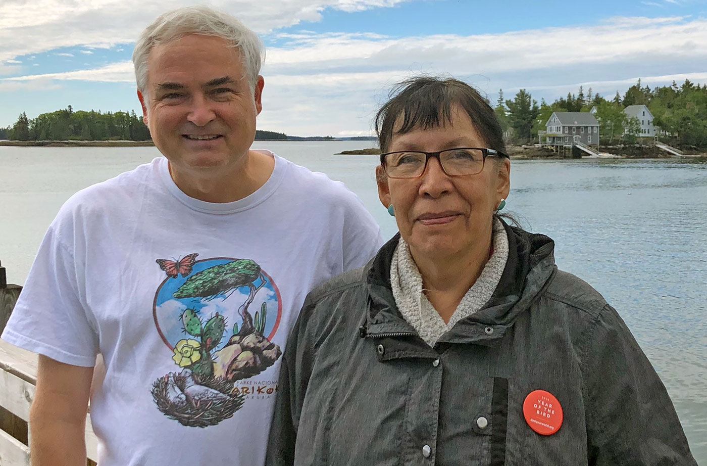 Jeff with Florence, visiting from the Northwest Territories and wearing her Year of the Bird pin, in front of the National Audubon Hog Island camp in Bremen, Maine. Courtesy of Jeff Wells