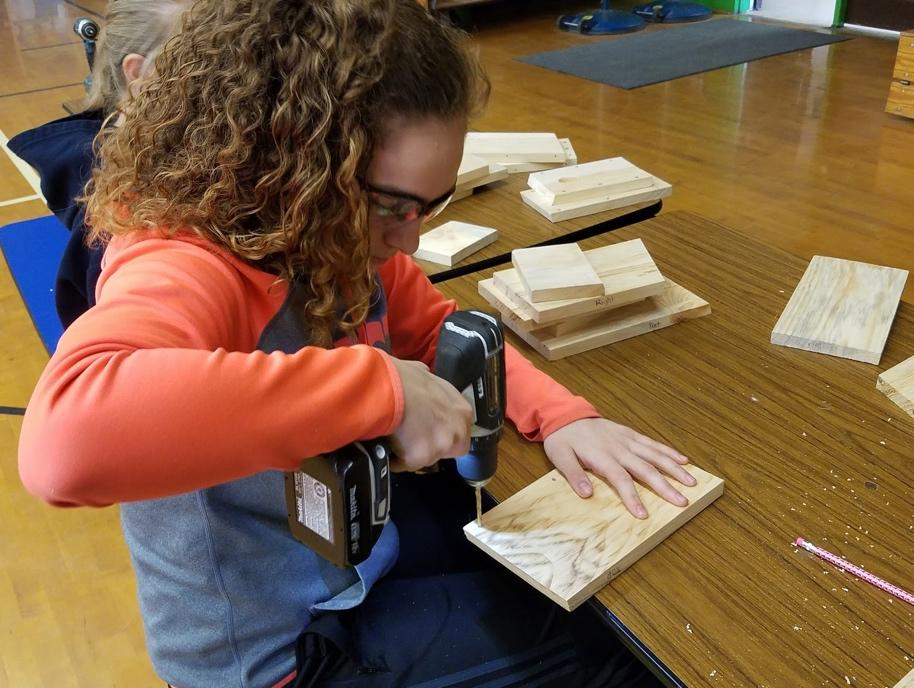 Natalie working on her birdhouse