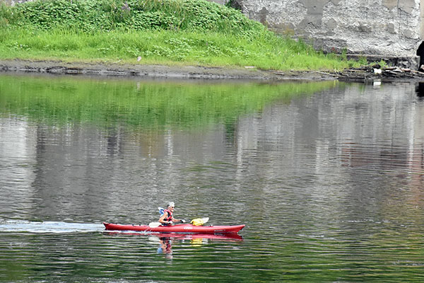 Lisa Pohlmann paddles past Edwards Dam