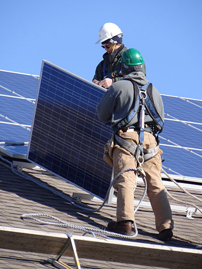solar workers installing panels