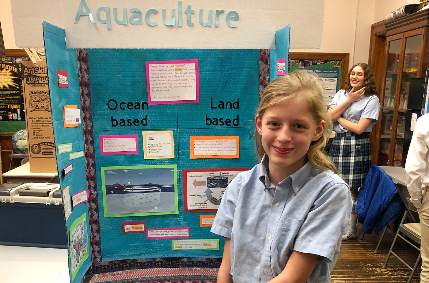 student with salmon aquaculture info