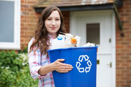 woman with recycle bin