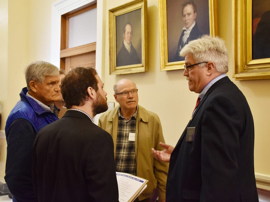 NRCM members speak with Sen. Bob Foley at Maine State House