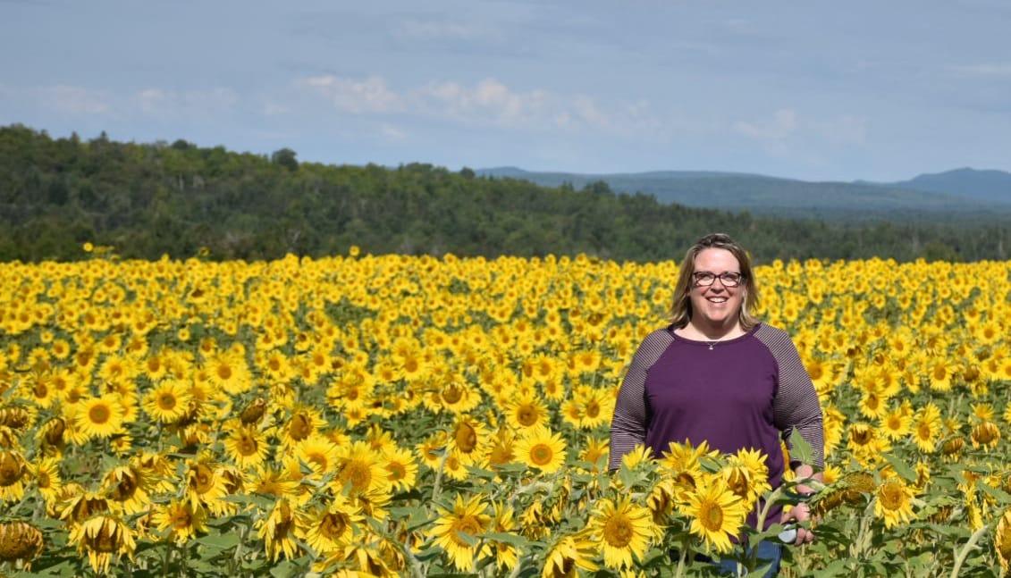 Beth in a sunflower field