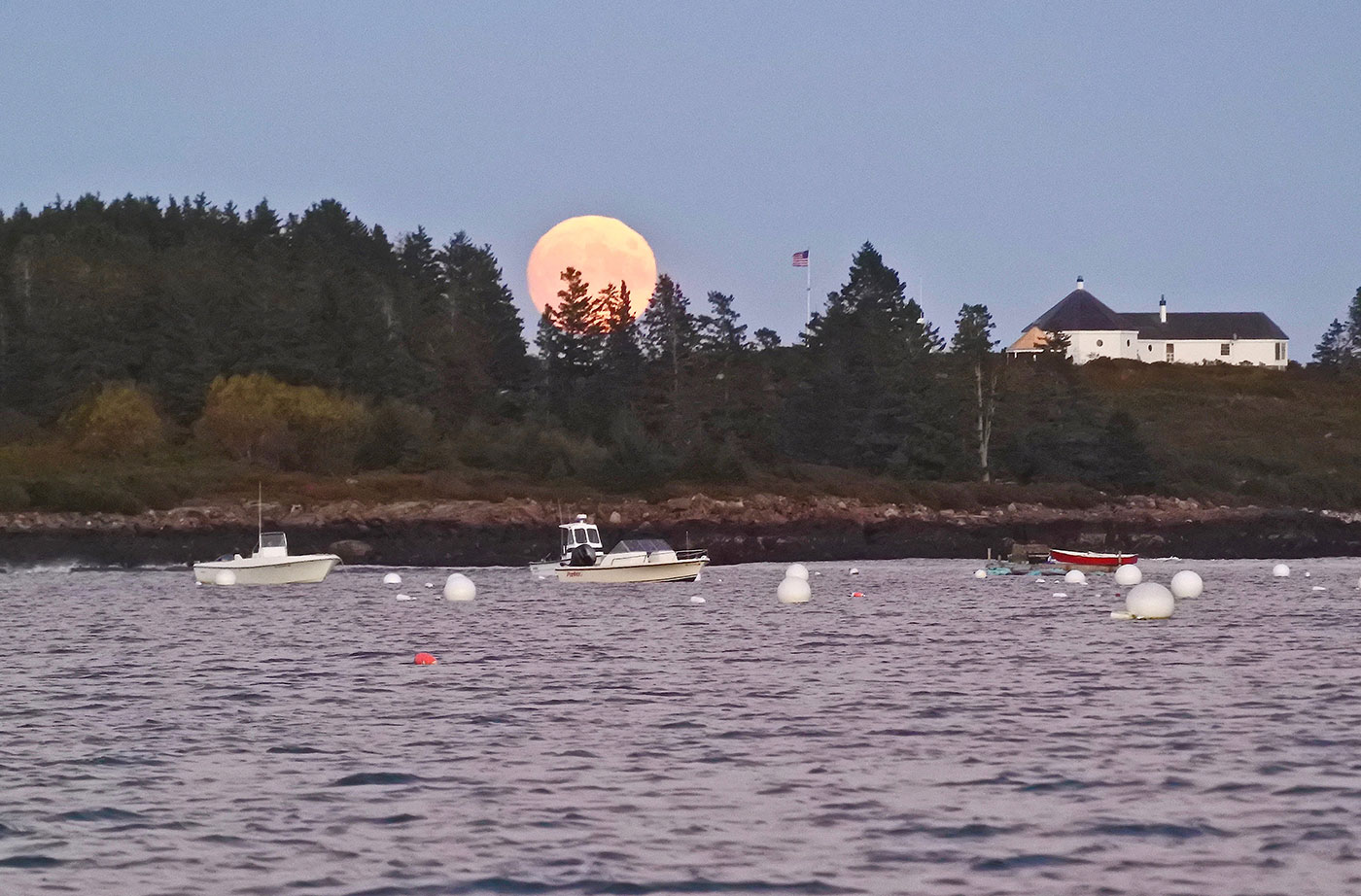 harvest moon over Maine coast