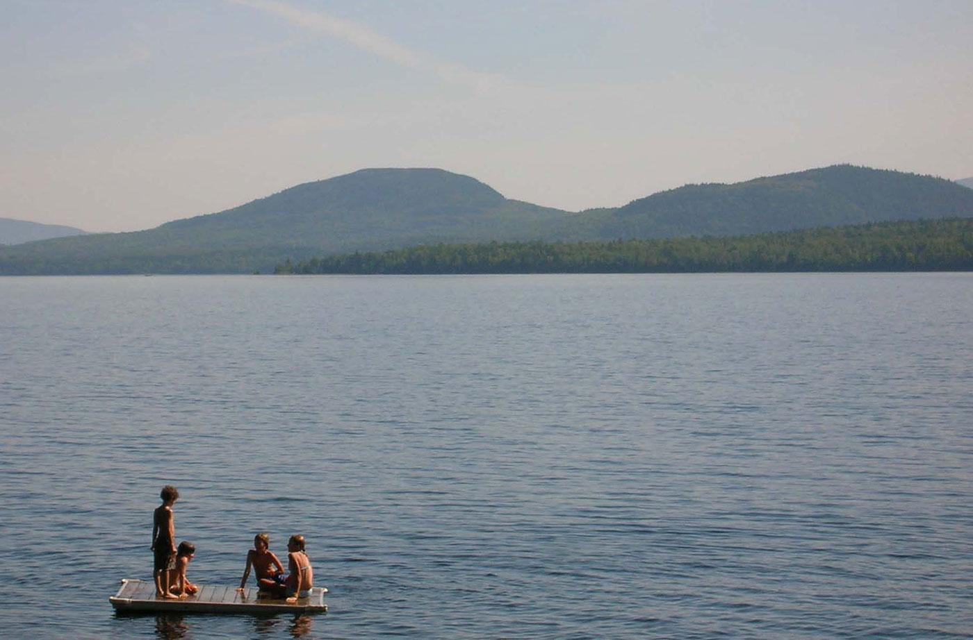 kids on dock in Moosehead Lake