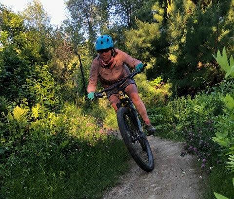 Mountain biking on wooded trail